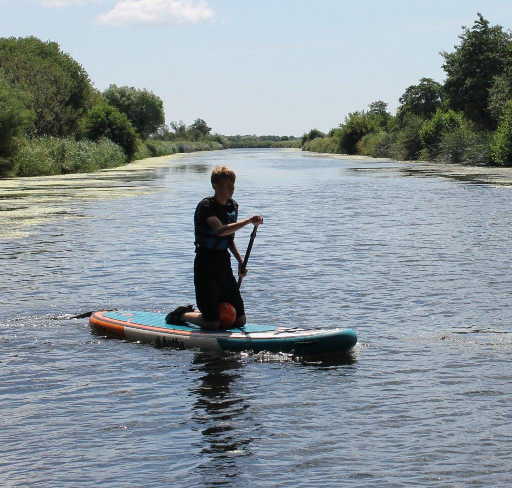 Barley Lane School - child on river, waterboarding